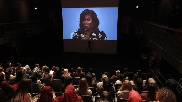 Michelle Obama appears via video link as part of a live conversation with pupils at the Mulberry School for Girls in London, as well as other girls around the world