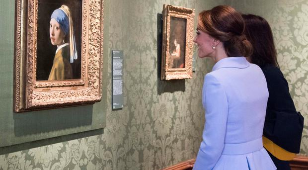 The Duchess of Cambridge views Girl with a Pearl Earring by Johannes Vermeer at the Mauritshuis in The Hague yesterday