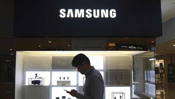 A man passes by a Samsung Electronics shop in Seoul, South Korea