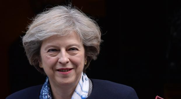 Theresa May leaves 10 Downing Street for Prime Minister's Questions