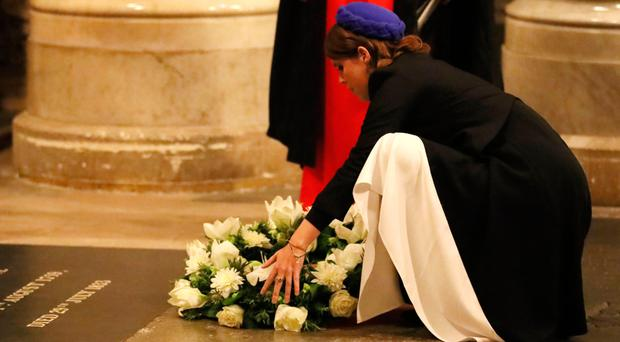 Princess Eugenie lays a wreath at Westminster Abbey in London during a service to commemorate the work of William Wilberforce