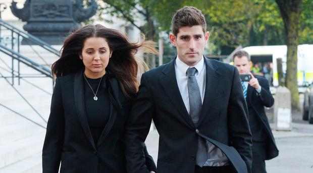 Footballer Ched Evans and partner Natasha Massey leave court yesterday