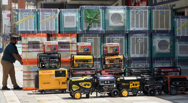 Air conditioners use hydrofluorocarbons, or HFCs - greenhouse gases far more powerful than carbon dioxide (AP)