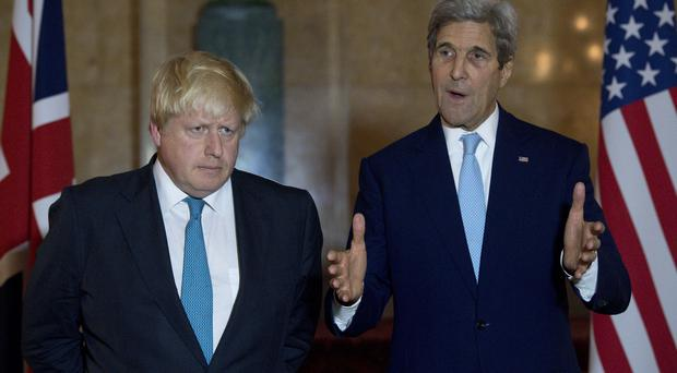 Boris Johnson, left, has said it may be time to consider 'more kinetic options' in Syria before a meeting with John Kerry in London