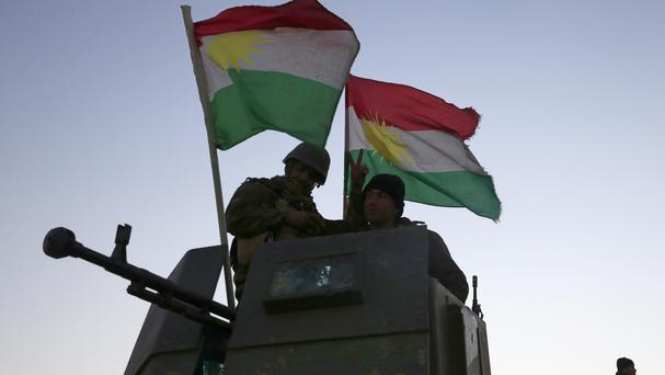 Kurdish Peshmerga fighters advance towards villages surrounding Mosul in Iraq (AP)