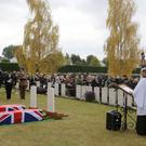The coffins of Private Harry Carter and Private William Marmon are laid together in Albert Communal Cemetery Extension in Albert, France.