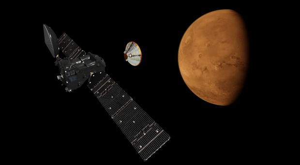 Artist's impression of the Schiaparelli lander detaching from the ExoMars Trace Gas Orbiter (European Space Agency/PA)