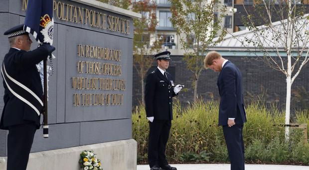 Prince Harry lays a wreath during the Metropolitan Police Service Annual Ceremony of Remembrance at the Metropolitan Police Training College in London