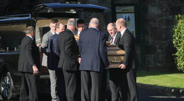 The coffin of Munster Rugby head coach Anthony Foley is brought to repose in St Flannan's Church
