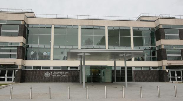 Gordon Anglesea ran a Home Office attendance centre in Wrexham, Mold Crown Court was told