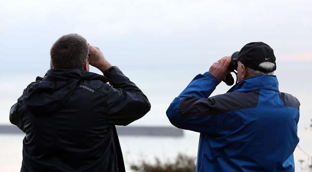 People gather on the cliffs of Dover as Russian warships are set to pass through the English Channel