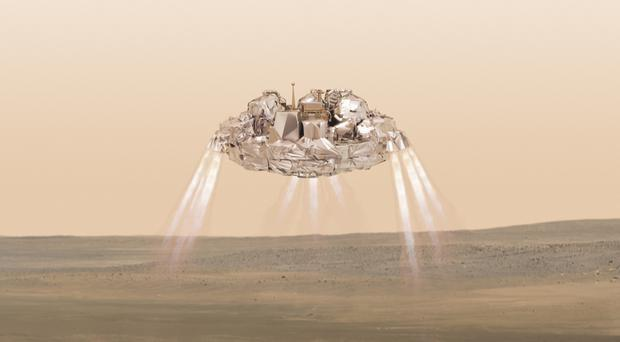 An artist's impression of the Schiaparelli module with thrusters firing.