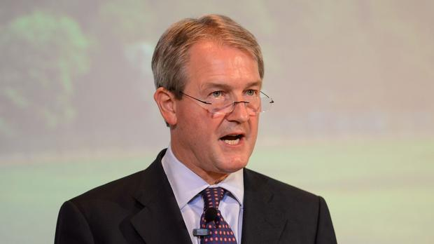 Owen Paterson will warn that Britain must confront problems with the NHS