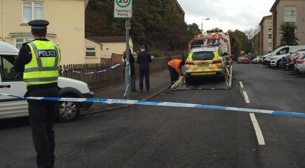 A police car is removed from the scene in the Drumchapel area of Glasgow