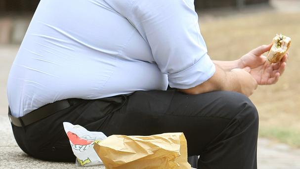 Experts say doctors should intervene even if overweight or obese patients see them about an unrelated matter.