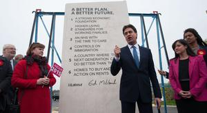 Former Labour leader Ed Miliband unveiling the party's pledges carved into a stone plinth