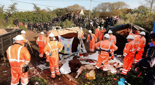 Workers continue with the demolition of the Jungle camp in Calais