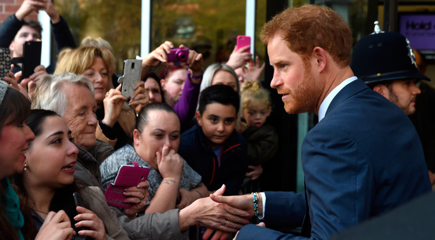 Prince Harry greets members of the public as he arrives to open Nottingham's new Central Police Station