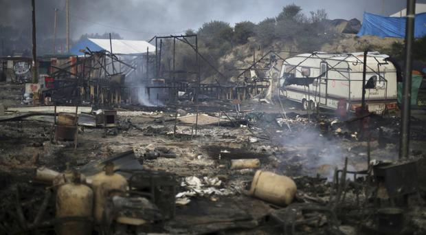 The Jungle after a series of fires were started by migrants as they left the makeshift camp (AP)