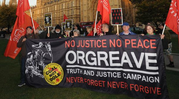 Members of the Orgreave Truth and Justice Campaign on College Green, outside Parliament