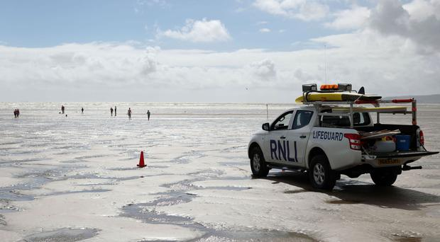 RNLI lifeguards at Camber Sands near Rye, East Sussex