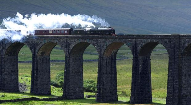 The Cumbrian Mountain Express crosses the Ribblehead Viaduct on a journey from York to Carlisle