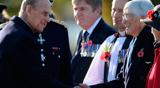 The Duke of Edinburgh meets Guinea Pig Club member Dr Sandy Saunders (right) at the National Memorial Arboretum in Staffordshire where he dedicated a memorial to the club