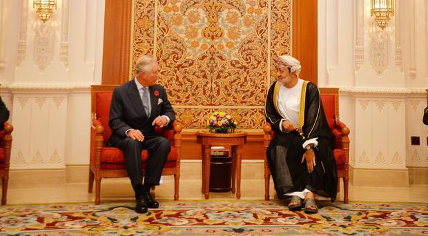 The Prince of Wales sits with HH Sayyid Haitham bin Tariq bin Taimur Al Said, after arriving at Muscat International Airport in Oman, to begin an official tour with his wife the Duchess of Cornwall