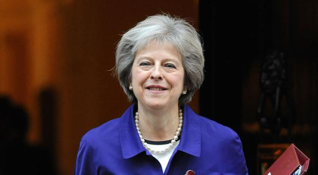 Theresa May is travelling to India on a mission to do the groundwork for an