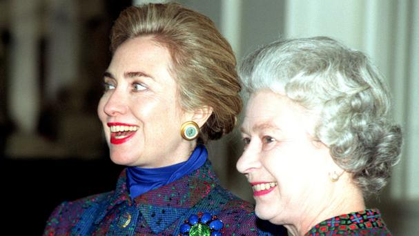 Hillary Clinton and The Queen share a joke in the Grand Entrance Hall of Buckingham Palace.