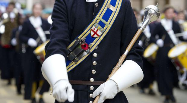 A member of Christ's Hospital school parades through the City of London during the Lord Mayor's Show