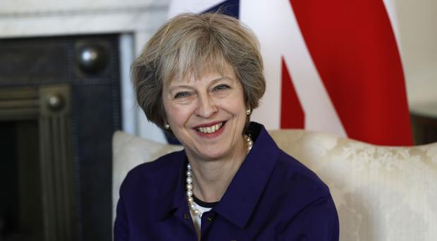 Theresa May refused to tip a winner but called for a 'calm and measured' US election