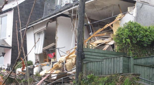 The collapsed flats in East Looe, Cornwall, where emergency crews found the body of Susan Norman, 68