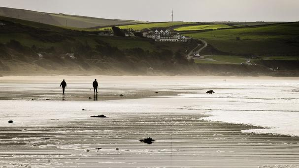 Dog walkers on Woolacombe beach, Devon, as forecasters warned of a cold snap