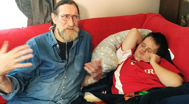 Paul Rutherford and his disabled grandson, Warren, are among those awaiting the outcome of the latest court hearing into the ''bedroom tax'