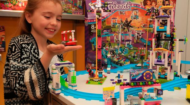 Isabella Parlour, 7, plays with the Lego Friends Amusement Park Roller Coaster