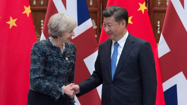 Theresa May, pictured here with Chinese President Xi Jinping, said she was excited about the opportunities for expanding trade and investment