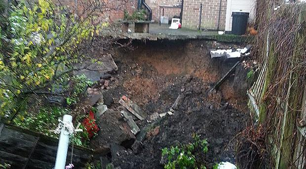 The sinkhole which swallowed gardens in Ripon, North Yorkshire, on Tuesday night. Seven houses have been evacuated after the 66ft wide hole appeared in Magdalen's Road. The picture was taken from the Twitter feed of @BendyPotter.
