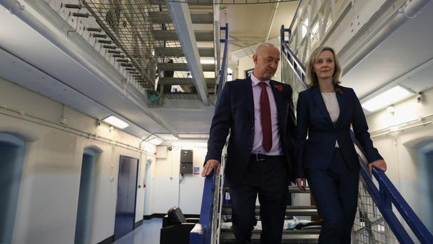 Liz Truss is escorted around HMP Brixton by the prison governor David Bamford