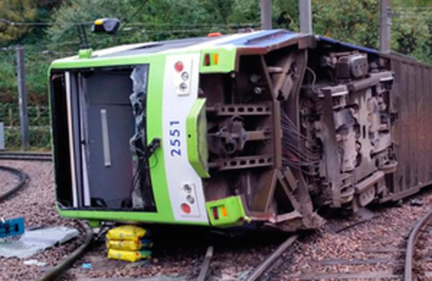 UK police bail driver in tram derailment that killed 7
