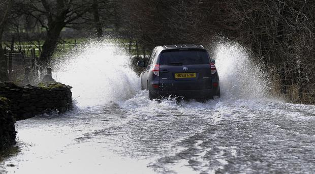 Driving through floodwater is dangerous and can wreck your car, the AA has warned