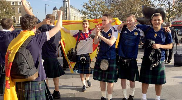 Scotland fans arrive from Edinburgh at King's Cross, London, as thousands of football fans descend on the capital for the England v Scotland World Cup qualifier.