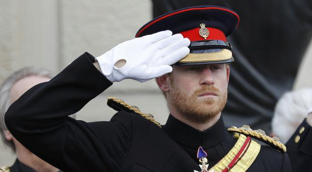 Prince Harry attending a Service of Remembrance at the Armed Forces Memorial at the National Memorial Arboretum in Staffordshire