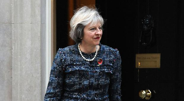 Prime Minister Theresa May will warn that those at the bottom of the economic ladder see globalisation as a job destroying, income cutting cause for concern