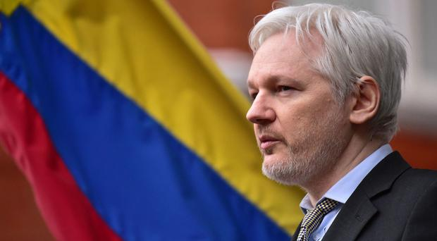 WikiLeaks founder Julian Assange on the balcony of the Ecuadorian Embassy