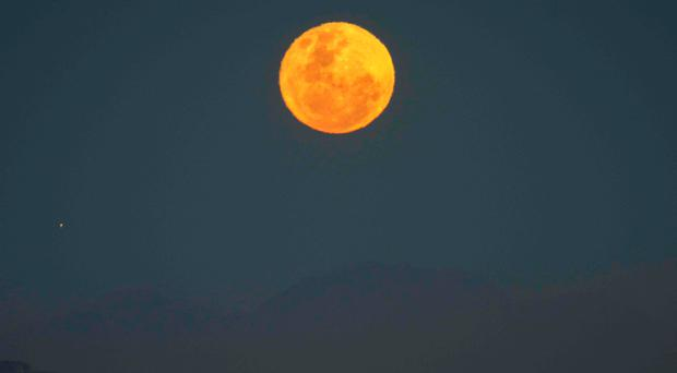 The supermoon setting in Cape Town in South Africa