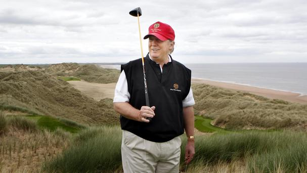 A flagpole on Donald Trump's Aberdeenshire golf course has been given retrospective planning permission by Holyrood ministers