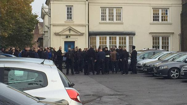 Prison officers outside Pentonville Prison in north London take part in a day of protest on Tuesday
