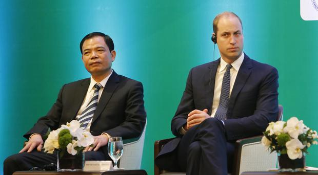 Vietnam's minister of agriculture Nguyen Xuan Cuong and the Duke of Cambridge listen to speeches at the conference (AP)