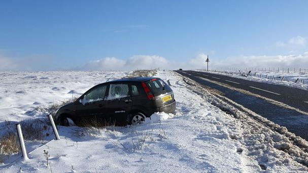 Snow settles along the summit of the Snake Pass, on the A57, in the Peak District